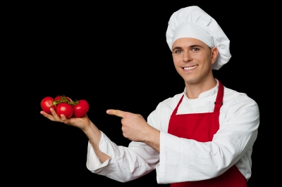 chef holding tomatoes
